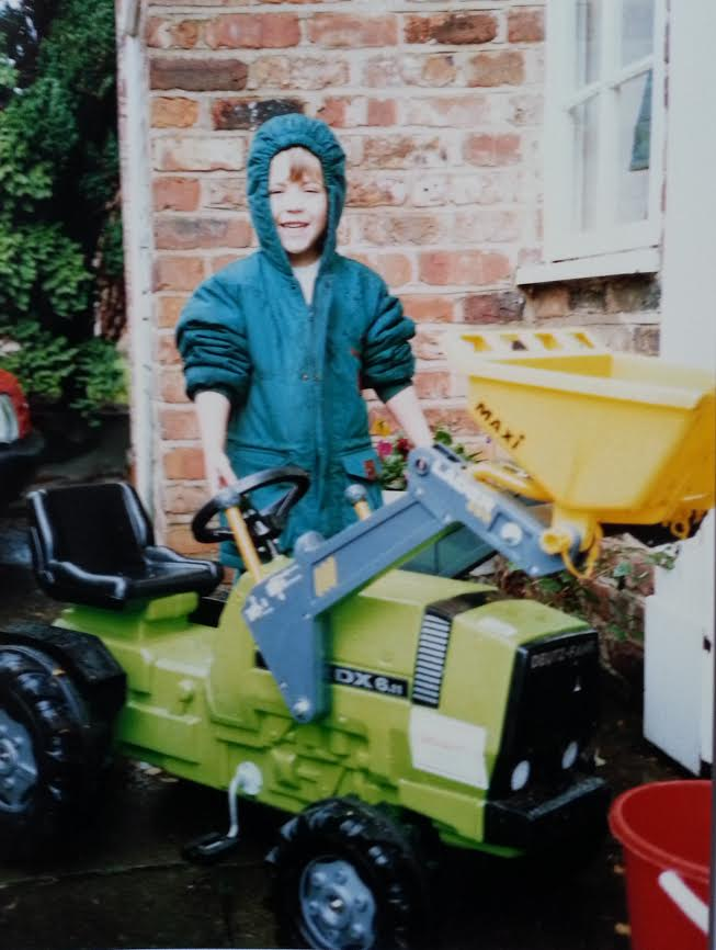 Me with a sit on toy tractor from my youth