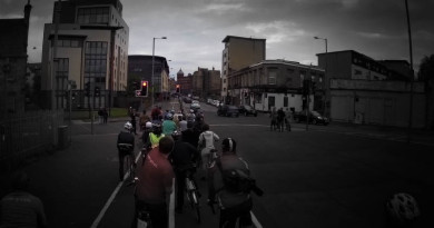 Cyclists waiting at red light