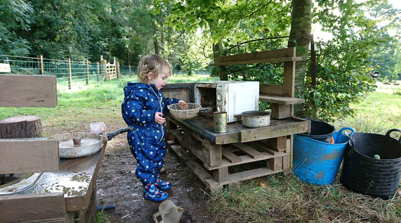 Mini-DarkerSide getting involved with the mud kitchen